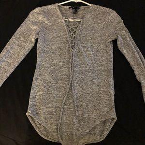 Grey long sleeve body suit
